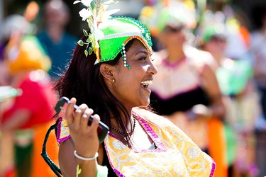 Members of the Trinidad and Tobago Cultural Association of Edmonton take part in the Cariwest Parade, in downtown Edmonton Alta. on Saturday Aug. 8, 2015. David Bloom/Edmonton Sun/Postmedia Network
