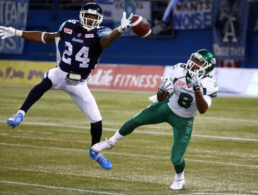 A.J. Jefferson of the Toronto Argos deflects a pass intended for Korey Williams of the Saskatchewan Roughriders during CFL action at the Rogers Centre in Toronto, Ont. on Saturday August 8, 2015. Dave Abel/Toronto Sun/Postmedia Network
