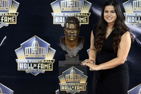 Sydney Seau poses with the bust of her late father Junior Seau at the 2015 Pro Football Enshrinement Cermony at Tom Benson Hall of Fame Stadium. (Andrew Weber-USA TODAY Sports)
