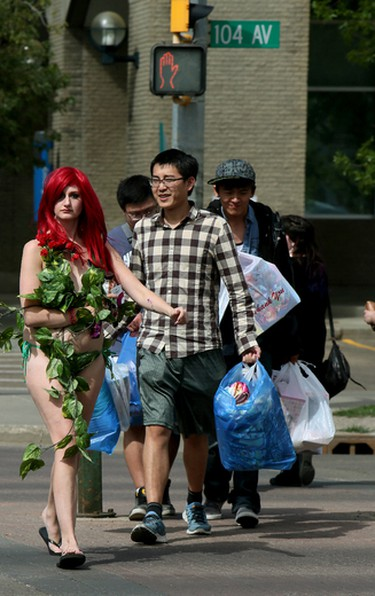Chantelle from Calgary crosses 104 Ave., at 108 St., in dowtown Edmonton on Friday Aug. 7, 2015. Chantelle was dressed as the DC Comics, character, Poison Ivy, one of Batman's adversary Supervillain in Gotham city. Chantelle is in town along with 100's of other Japanese Animation fans to attend the 22nd annual Animethon at Grant MacEwan University downtown campus Aug 7th to 9th. Tom Braid/Edmonton Sun/Postmedia Network