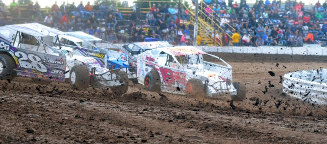 358 modifieds, shown churning up the mud in this August 2015 file photo, raced against big blocks in the eighth Bob St. Amand Sr. Memorial Wednesday night in Thorold. BERND FRANKE/Postmedia News