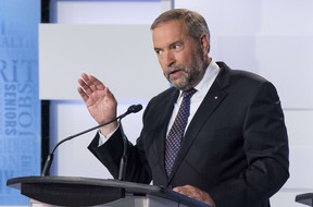 NDP Leader Thomas Mulcair makes a point during the first leaders debate Thursday, August 6, 2015 in Toronto. (AFP PHOTO / Pool / FRANK GUNN)