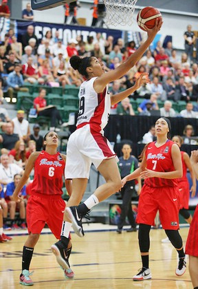 Miranda Ayim charges for Canada against Puerto Rico during the FIBA Americas tournament opener at the Saville Centre last night.