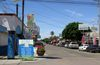In this Thursday, April 30, 2015 photo, a street full of a dental offices is seen in Los Algodones, Mexico, which sits on the border with California. Thousands of Americans and Canadians travel to Los Algodones each year for affordable and reliable dental work from dentists who speak English and sometimes accept U.S. insurance. (AP Photo/Astrid Galván)