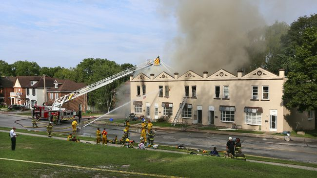Firefighters continue to battle a fire in a 10 plex on 4th Ave E on Monday August 10, 2015 in Owen Sound, Ont. Fire crews from the Owen Sound Inter Township Fire Dept.  and the Chatsworth Fire Dept. were called in at around 4am Monday to help the Owen Sound Fire Dept. battle multiple fires in the city. Officials say they are investigating 6 separate fire scenes in the city.  James Masters/Owen Sound Sun Times/Postmedia Network
