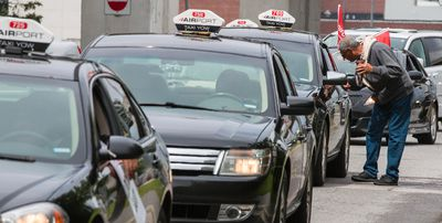 A long line of airport taxi drivers protest a new contract between the airport and Coventry Connections that would require drivers to pay $5.00 per trip for fares from the airport. Tuesday August 11, 2015. Errol McGihon/Ottawa Sun/Postmedia Network