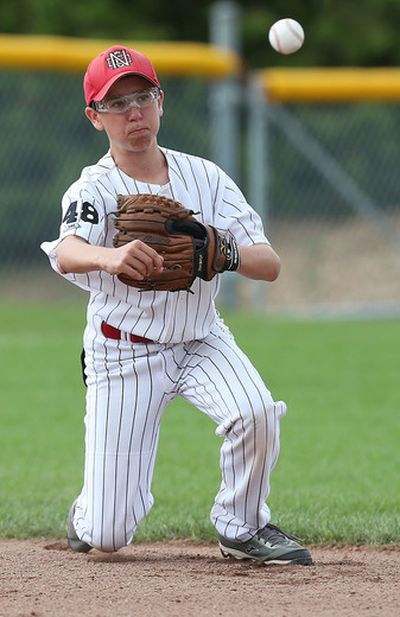 Justin Ricci from Quebec takes a grounder against the High Park Braves at the Ken Ross Park in Ottawa Tuesday Aug 11, 2015. Nepean is hosting the Canadian Little League Championship in Ottawa August 7-16. Tony Caldwell/Ottawa Sun/Postmedia Network