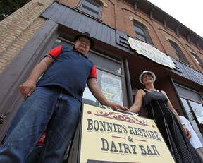 Wayne Boyle, owner of Bonnie's Restore and Dairy Bar stands with his common-law partner Barbara Isaac in front of the second-hand store that must move to a new location.(Shaun Gregory/Huron Expositor)