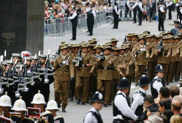 Gurkhas march during the parade to commemorate VJ day as it passes along Whitehall in London, Saturday, Aug. 15, 2015. The parade, comprised of veterans of the Far East Campaign, their families and descendants, led by Pipes and Drums drawn from the Army, was to mark the 70th anniversary of the victory over Japan during World War II. (AP Photo/Kirsty Wigglesworth)