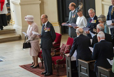 Britain's Queen Elizabeth II , left and, Philip, the Duke of Edinburgh attend a service at St  Martin-in-the-Fields Church, in London, marking the 70th anniversary of VJ Day, Saturday Aug. 15, 2015. Queen Elizabeth II is leading ceremonies in Britain to mark the 70th anniversary of the victory over Japan during World War II. (Arthur Edwards/Pool Photo via AP)