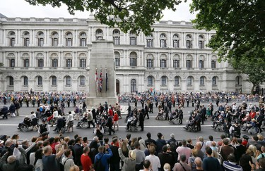 A parade to commemorate VJ day passes the Cenotaph on Whitehall in London, Saturday, Aug. 15, 2015. The parade, comprised of veterans of the Far East Campaign, their families and descendants, led by Pipes and Drums drawn from the Army, was to mark the 70th anniversary of the victory over Japan during World War II. (AP Photo/Kirsty Wigglesworth)