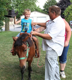 Stratton Matthew, 6, rides like a cowboy at the Bethel Bible Church Carnival in Seaforth.(Shaun Gregory/Huron Expositor)
