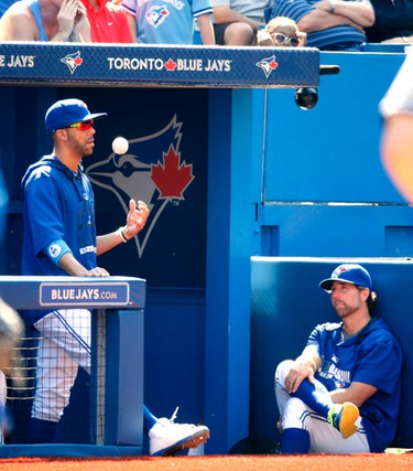 Toronto pitchers David Price and R. A. Dickey (r) talk during a Yankee at bat near the end of the game as Toronto Blue Jays lost 4-1 to the New York Yankees in Toronto, Ont. on Monday August 10, 2015. Michael Peake/Toronto Sun/Postmedia Network
