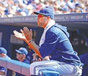 Always the 'people person,' as his mom refers to him, David Price cheers on his Blue Jays teammates from the dugout during yesterday's game against the Yankees. (MICHAEL PEAKE, Toronto Sun)