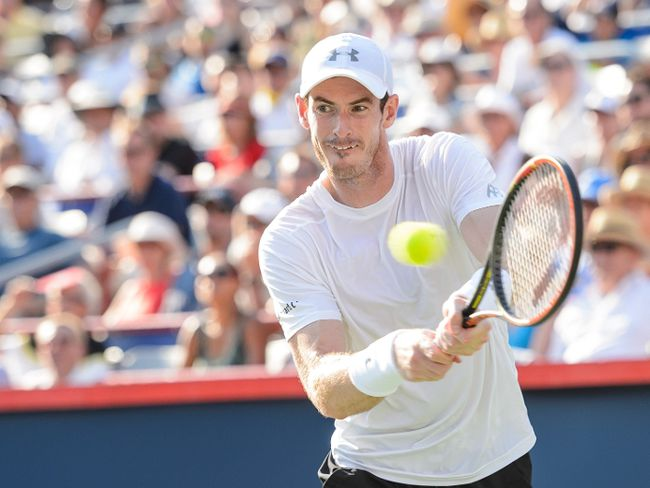 Andy Murray of Great Britain hits a return against Novak Djokovic of Serbia during day seven of the Rogers Cup at Uniprix Stadium on August 16, 2015 in Montreal, Quebec, Canada.   Minas Panagiotakis/Getty Images/AFP