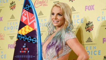 """Britney Spears took home the surfboard for Choice Style Icon at the 2015 Teen Choice Awards Sunday in in Los Angeles. The singer proved why she won the title with a new hair-do and revealing dress. (REUTERS/Danny Moloshok)Like the look?  PDRTJS_settings_8213542 = { """"id"""" : """"8213542"""", """"unique_id"""" : """"default"""", """"title"""" : """""""", """"permalink"""" : """""""" }; (function(d,c,j){if(!document.getElementById(j)){var pd=d.createElement(c),s;pd.id=j;pd.src=('https:'==document.location.protocol)?'https://polldaddy.com/js/rating/rating.js':'http://i0.poll.fm/js/rating/rating.js';s=document.getElementsByTagName(c)[0];s.parentNode.insertBefore(pd,s);}}(document,'script','pd-rating-js'));"""