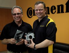 Bill Gillier, Continental's North America director of actuator research and development, left, and Thomas Stierle, vice president of actuators, display two of the many products designed at the Chatham Continental facility. The group celebrated 70 years as an international automotive supplier. Photo taken in Chatham, Ont. on Saturday August 15, 2015. (Diana Martin, The Daily News)