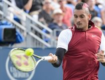 Nick Kyrgios of Australia hits a return against John Isner of the USA during day four of the Rogers Cup at Uniprix Stadium on August 13, 2015 in Montreal, Quebec, Canada.   Minas Panagiotakis/Getty Images/AFP