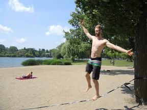 Teddy Brescacin practices rope walking at Mooney's Bay Park on a stifling day in the city on Monday, Aug. 17, 2015 where the temperature soared to 39C with the humidex. JULIE BAY/Ottawa Sun