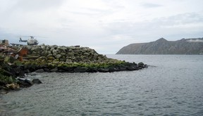 This Aug. 30, 2011, file photo provided by the U.S. Army Corps of Engineers shows Big Diomede Island in Russia, right background, as seen from Little Diomede Island in the U.S. state of Alaska, left foreground. (George A. Kalli/U.S. Army Corps of Engineers via AP, File)