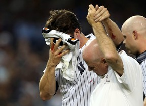 New York Yankees pitcher Bryan Mitchell is helped off the field after being hit in the face by a baseball against the Minnesota Twins during the second inning at Yankee Stadium Monday. (Adam Hunger/USA TODAY Sports)