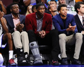 Philadelphia 76ers' Jerami Grant, left, Joel Embiid, middle, and Michael Carter-Williams, right, watch from the bench during a preseason game against the Charlotte Hornets in Philadelphia. (AP Photo/Michael Perez, File)