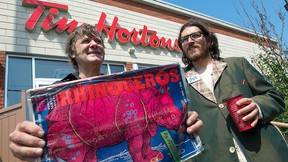 Rhinoceros Party leader Sebastien CoRhino Corriveau, right, and candidate Ben 97 Benoit stand in front of a coffee shop Monday, Aug. 17, 2015 in Montreal. THE CANADIAN PRESS/Paul Chiasson