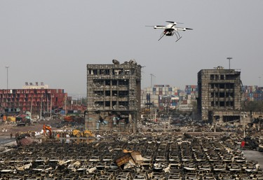A drone operated by paramilitary police flies over the site of last week's explosions at Binhai new district in Tianjin, China, August 17, 2015. (REUTERS/Kim Kyung-Hoon)