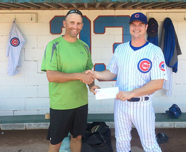 Warren Beisel of the Power Worker's Union presents the $1,500 cheque to the Kincardine Cubs' Chris Inkster. The money will help purchase a portable batting screen, which will be available to all Kincardine Minor Baseball teams.