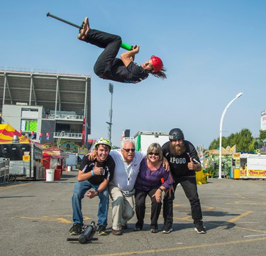 Dan Mahoney of the XPogo Stunt Team - bounces over CNE GM Virginia Ludy and CNE President Brian Ashton, and fellow pogo jumpers Ryan O'Malley (left) and Bryan Pognant (right) during CNE Media Preview Day for the 2015 Canadian National Exhibition in Toronto, Ont.  on Wednesday August 19, 2015. Ernest Doroszuk/Toronto Sun/Postmedia Network