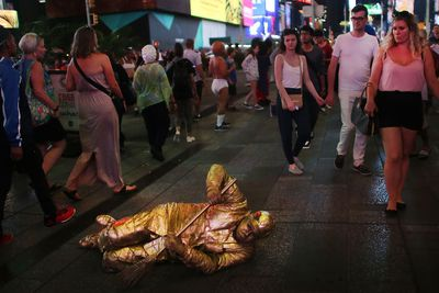 A street performer works for tips in Times Square on August 19, 2015 in New York City. (Spencer Platt/Getty Images/AFP)