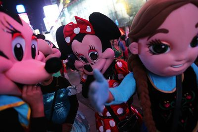 Street performers in costumes take a break in Times Square on Aug. 19, 2015 in New York City. (Spencer Platt/Getty Images/AFP)