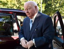 Former Conservative senator Mike Duffy arrives at the courthouse in Ottawa, for the second day of testimony by Benjamin Perrin, former legal adviser for the Prime Minister's Office, on Friday, Aug. 21, 2015. Duffy is facing 31 charges of fraud, breach of trust, bribery, frauds on the government related to inappropriate Senate expenses. THE CANADIAN PRESS/Justin Tang