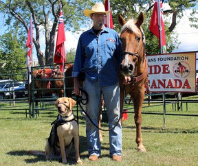 Lawrence Christensen with service dog Lynx, and his transportation for the day Skip, as part of the Communities for Veterans Foundation's Ride Across Canada, which stopped in Kingston. on Saturday.  Steph Crosier/The Whig-Standard