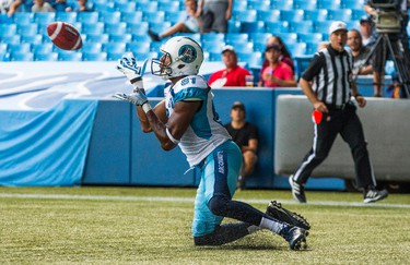 Toronto Argonauts Tori Gurley catches a touchdown against the Ottawa RedBlacks during the first half of CFL football action in Toronto, Sunday August 23, 2015. THE CANADIAN PRESS/Mark Blinch