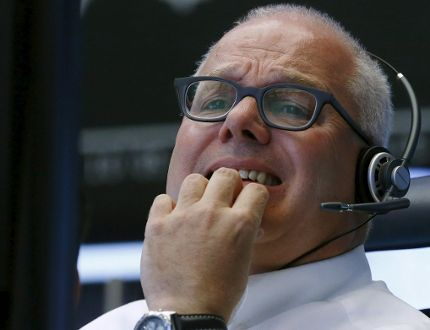 A trader reacts at his desk in front of the DAX board at the Frankfurt stock exchange, Germany, August 24, 2015. (REUTERS/Ralph Orlowski)