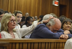 Barry Steenkamp, father of Reeva Steenkamp, is consoled by his wife June Steenkamp during the sentencing hearing of Olympic and Paralympic track star Oscar Pistorius at the North Gauteng High Court in Pretoria on October 15, 2014.  (REUTERS/Antoine de Ras)
