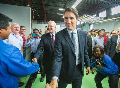 Federal Liberal leader Justin Trudeau greets supporters as he is joined by former Canadian Prime Minister Paul Martin (back) during a campaign stop at InspecTech in the Scarborough area in Toronto, Ont. on Tuesday August 25, 2015. Ernest Doroszuk/Toronto Sun/Postmedia Network