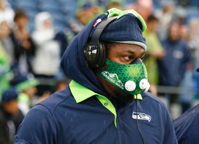 Seattle Seahawks running back Marshawn Lynch wears a high-altitude training mask during warm-ups before the Seahawks' preseason NFL football game against the Denver Broncos, Friday, Aug. 14, 2015, in Seattle. (AP Photo/John Froschauer)
