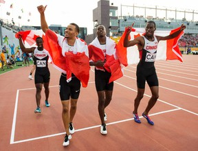 Canadian teammates celebrate after the men's 4x100 at the 2015 Pan Am Games in Toronto on Saturday, July 25, 2015. The Canadian men's 4x100-metre relay team was disqualified at the Pan American Games, denying sprinter Andre De Grasse a third gold medal. (Frank Gunn/THE CANADIAN PRESS)