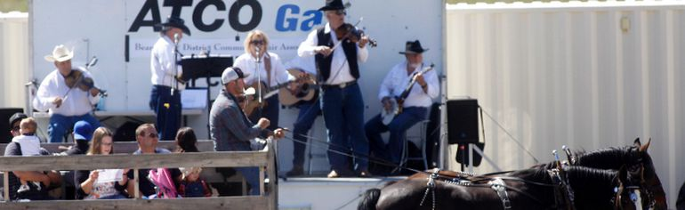 Wagon riders are serenaded by Pure Country presented by the Old Tyme Bench Exhibition, formerly Bearspaw Fair as they are now part of the Cochrane Fall Fair. Patrick Price /Cochrane Times/ Postmedia Network