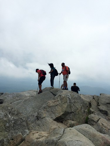 This July 20, 2015 photo shows the peak of Mount Monadnock, elevation 3,165 feet, in Jaffrey, N.H., which draws more than 100,000 hikers yearly. (AP Photo/Lindsey Tanner)