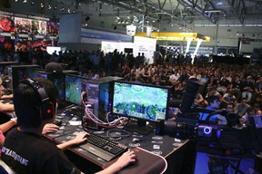 Members of team Team SoloMid (TSM) from the United States are shown competing during the 2011 League of Legends competition of the Intel Extreme Masters Gamescom in Cologne, Germany in this publicity photo released on August 17, 2012.