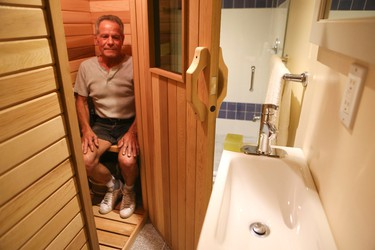 George Samaras shows off his sauna inside his 71/2-foot wide house going on sale for $750,000 on Shuter St in Toronto on Wednesday August 26, 2015. Veronica Henri/Toronto Sun/Postmedia Network