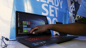 A Microsoft delegate checks applications on a computer during the launch of the Windows 10 operating system in Kenya's capital Nairobi, July 29, 2015. REUTERS/Thomas Mukoya