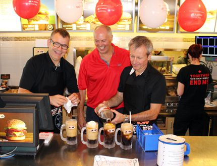 Kenora A&W owner Randy Nickle (centre) is joined by Multiple Sclerosis Society of Canada president and CEO Yves Savoie (left) and A&W Food Services of Canada president and CEO Paul Hollands in serving up root beer floats during the Cruisin' To End MS campaign at the Kenora restaurant, Thursday, Aug. 27. REG CLAYTON/Daily Miner and News