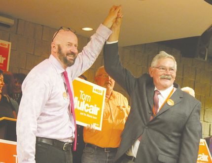 Doug Hart (right) of Ponoka and City of Red Deer Coun. Paul Harris celebrate Monday night at the Red Deer Public Library after winning NDP nomination races to run in the Red Deer-Lacombe and