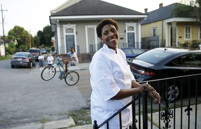 Keisha Henry poses for a photo outside her Cafe Dauphine, in the Lower Ninth Ward in New Orleans, Tuesday, Aug. 25, 2015. For now, the post-Katrina restaurant boom has only one outpost in the Lower 9th Ward, one of the city�s hardest-hit neighborhoods. Longtime resident Keisha Henry opened Cafe Dauphine with relatives, marking a rare sit-down restaurant in an area that traditionally has had only corner stores and takeout.  (AP Photo/Gerald Herbert)