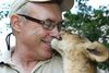 Michael Hackenberger holding an African lion cub at the Bowmanville Zoo in July 2014. (Veronica Henri/Toronto Sun)