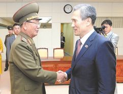 In this photo provided by the South Korean Unification Ministry, South Korean presidential security adviser Kim Kwan-jin, right, shakes hands with Hwang Pyong So, North Korea's top political officer for the Korean People's Army, after their meeting at the border village of Panmunjom earlier this week. (The South Korean Unification Ministry/ Associated Press)
